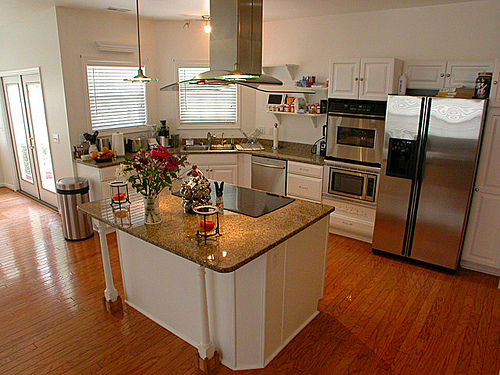 Kitchen with stainless appliances and center isalnd